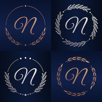 Letter n met bloemenframe logo sjabloon