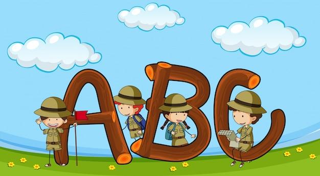 Lettertype abc met kinderen in uniform voor jongens