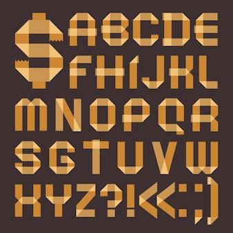 Lettertype van geelachtig plakband - romeins alfabet (a, b, c, d, e, f, g, h, i, j, k, l, m, n, o, p, q, r, s, t, u , v, w, x, y, z)