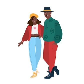 Leuk afrikaans amerikaans paar dat trendy kleding in 80-s stijl draagt. jonge man en vrouw gekleed in retro kleding uit de jaren 80