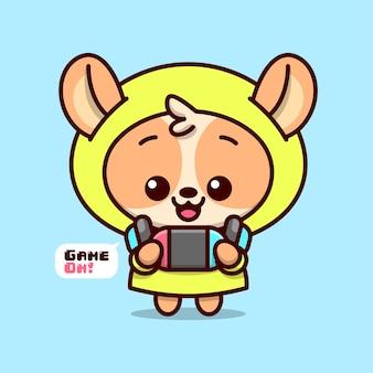 Leuk bruin puppy in gele hoodie jas met blauwe oortelefoon speelt game