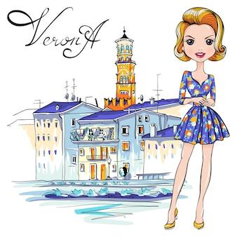Leuk fashionale meisje in gebloemde jurk, verona, italië. adige river embankment en tower lamberti op de achtergrond