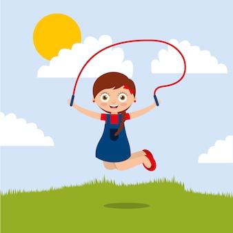 Leuk glimlachend meisje die met touwtjespringen in het park springen