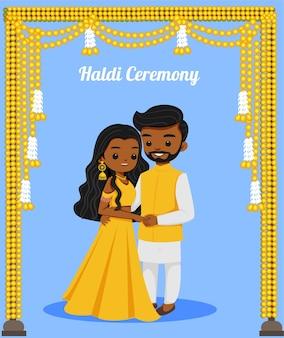 Leuk indisch paar in haldi-outfit voor huwelijksceremonie