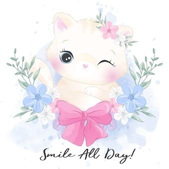 Leuk klein katje met bloemenportret