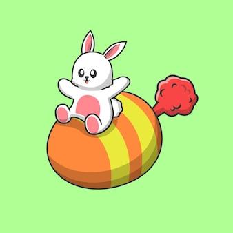 Leuk konijn dat met ei vliegt dat op groen wordt geïsoleerd