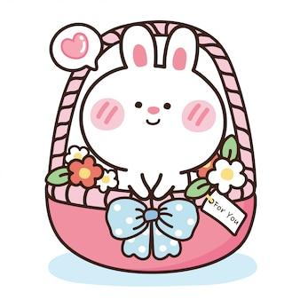 Leuk konijn met bloem in roze mand.