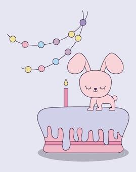 Leuk konijn met cake van verjaardag en slingers het hangen
