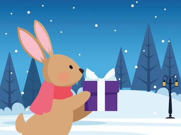 Leuk konijntje met giftdoos over de winternacht, kleurrijke vrolijke kerstmis, illustratie