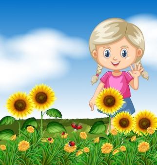 Leuk meisje in zonnebloemtuin