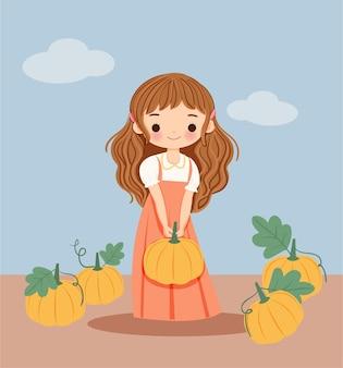 Leuk meisje met pompoenen voor winterfestival