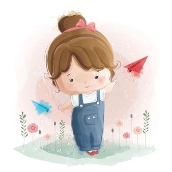 Leuk meisje spelen met vliegtuig papier