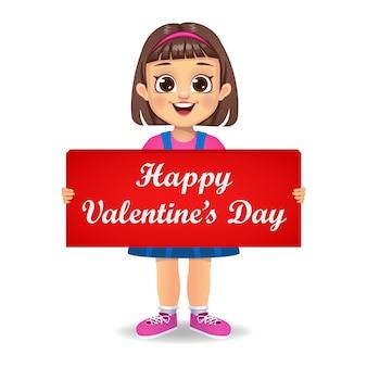 Leuk meisjesjonge geitje dat de gelukkige banner van de valentijnskaartendag houdt