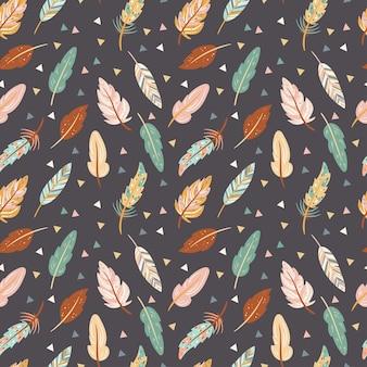 Leuk naadloos patroon in bohostijl kleurrijke veren op de donkere achtergrond tribale veer Premium Vector
