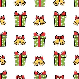 Leuk naadloos patroon met kerstdooscadeau en bellen