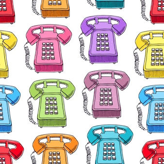 Leuk naadloos patroon van veelkleurige vintage telefoons.
