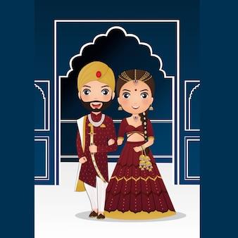 Leuk paar in traditionele indiase jurk stripfiguur. romantische bruiloft uitnodigingskaart