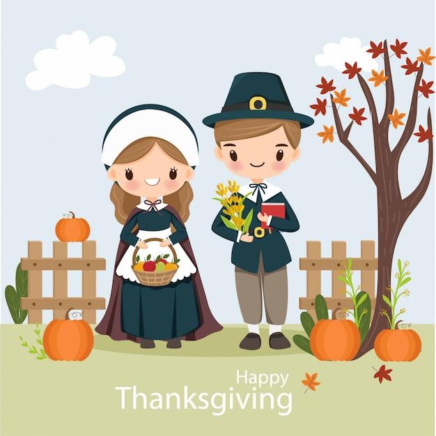 Leuk pelgrimsjongen en meisje met pompoen voor thanksgiving day
