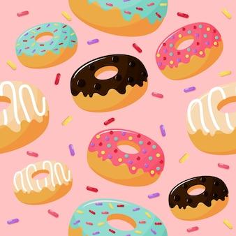 Leuk zoet donuts naadloos patroon. zomerse desserts op roze