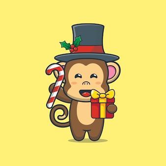 Leuke aap met kerstsnoep en cadeau leuke kerst cartoon afbeelding