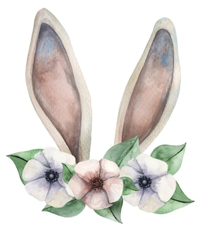 Leuke aquarel konijn oren met een bloem krans voor pasen.
