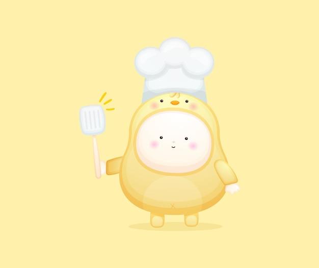 Leuke babychef-kok in kuikenskostuum. mascotte cartoon afbeelding premium vector