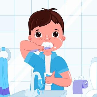 Leuke babyjongen die haar tanden in de ochtend borstelt. dagelijkse routine. mondhygiëne.