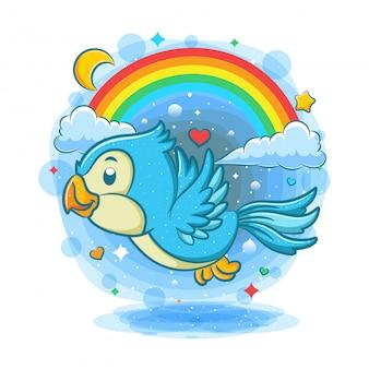 Leuke blauwe vogel die met regenboogachtergrond vliegt