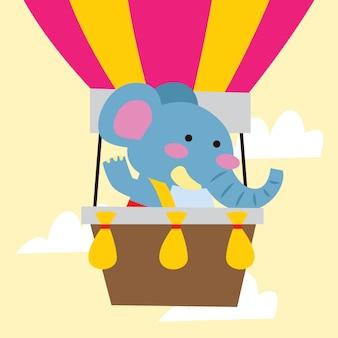 Leuke cartoonolifant die door hete luchtballon reizen