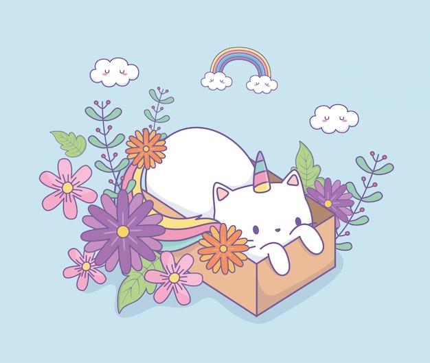 Leuke caticorn met florale decoratie in kartonnen doos
