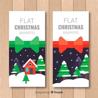 Leuke die kerstmisbanner met de winterlandschap in vlak ontwerp wordt geplaatst
