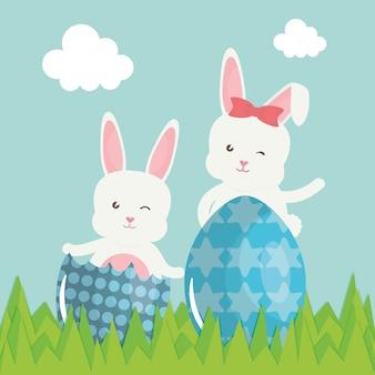 Leuke die konijnen met paaseieren in het gebied worden geschilderd