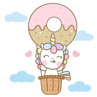 Leuke eenhoornvector in het beeldverhaal van de doughnutballon