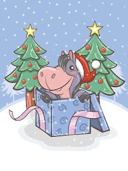 Leuke ezel met een geschenkdoos en een kerstboom - cartoon karakter illustratie