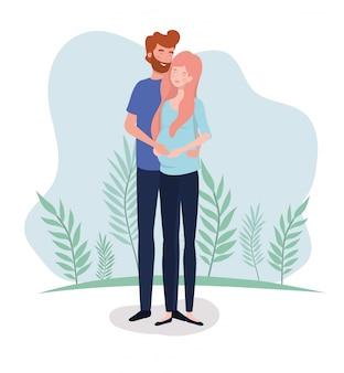 Leuke geliefden koppelen zwangerschapskarakters in het landschap