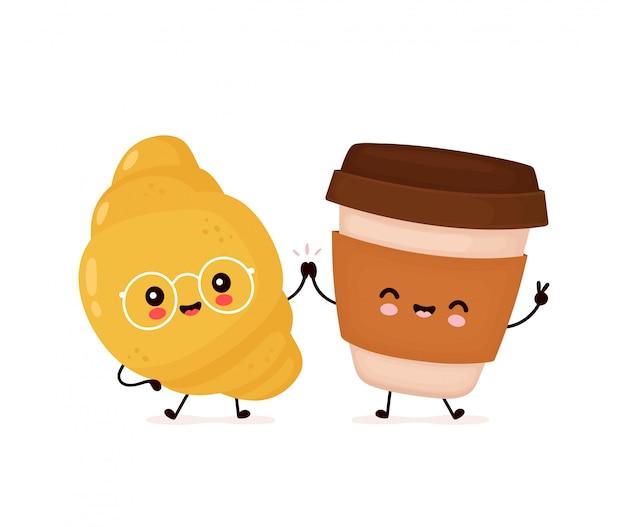 Leuke gelukkige glimlachende croissant en koffiekop.