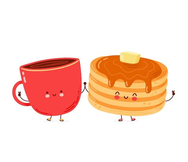 Leuke gelukkige grappige pannenkoeken en koffiemok. geïsoleerd