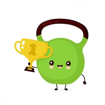 Leuke glimlachende gelukkige geschiktheid kettlebell met gouden trofee. platte cartoon karakter illustratie pictogram. geïsoleerd op wit. kracht kettlebell gewicht, sport, sportschool mascotte karakter