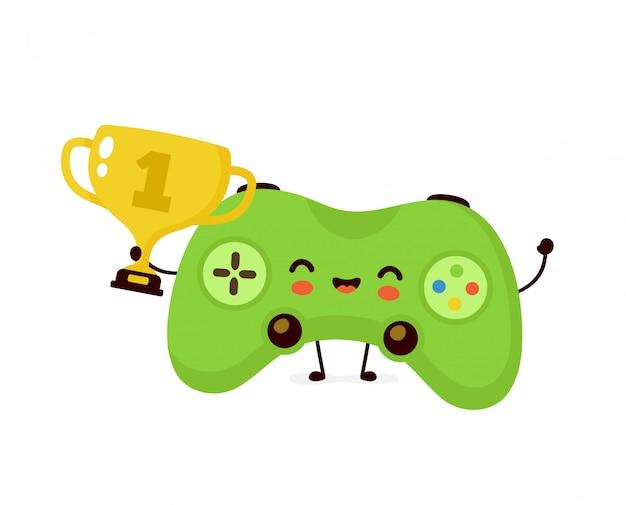 Leuke glimlachende gelukkige speljoystick houdt gouden trofeekop. platte cartoon karakter illustratie. geïsoleerd op een witte achtergrond. game joystick met winnaar trofee cup karakter concept