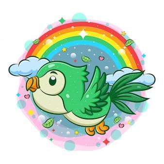 Leuke groene vogel die met regenboogachtergrond vliegt