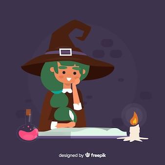 Leuke halloween-heks met drankje en kaars