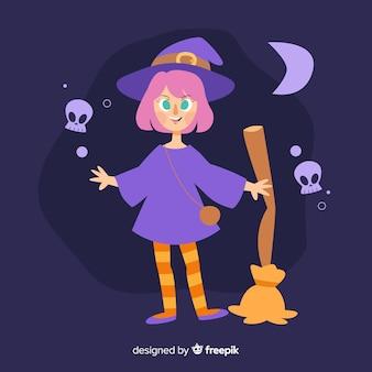 Leuke halloween-heks met een bezem