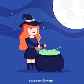 Leuke halloween-heks met een drankje pot