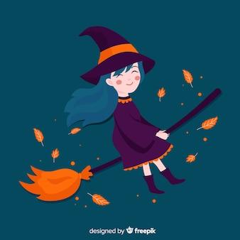 Leuke halloween-heks op een bezem