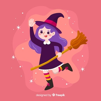 Leuke halloween-heks op roze achtergrond