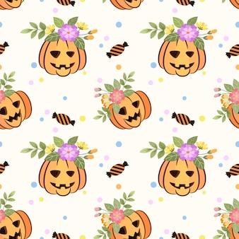 Leuke halloween-pompoen met bloemen naadloos patroon.