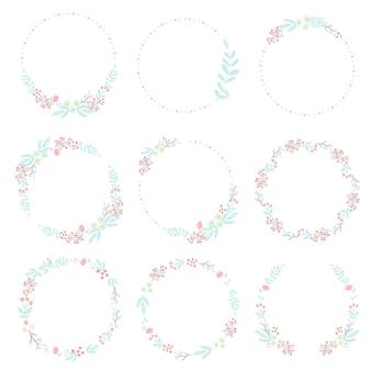 Leuke hand tekenen stijl pastel roze en blauwe lente kleine bloem en blad krans collectie