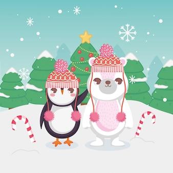 Leuke ijsbeer en pinguïn met vrolijke kerstmis van het suikergoedriet