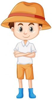 Leuke jongen die hoed en laarzen draagt