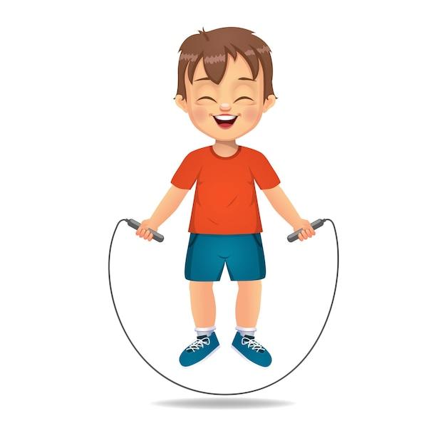 Leuke jongen die touwtjespringen speelt, touwtjespringt